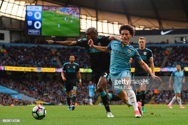 West Bromwich Albion's Frenchborn Cameroonian defender Allan Nyom defends against Manchester City's German midfielder Leroy Sane during the English...