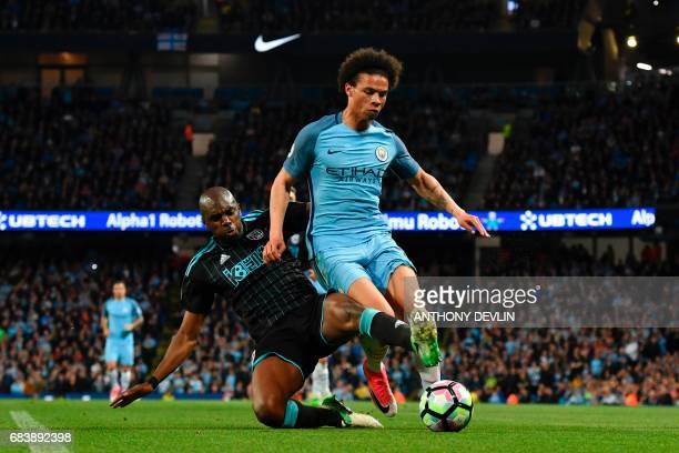 West Bromwich Albion's Frenchborn Cameroonian defender Allan Nyom tackles Manchester City's German midfielder Leroy Sane during the English Premier...
