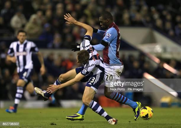 West Bromwich Albion's Gareth McAuley and Aston Villa's Christian Benteke battle for the ball