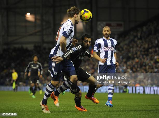 West Bromwich Albion's Gareth McAuley and Chelsea's Mohamed Salah battle for the ball