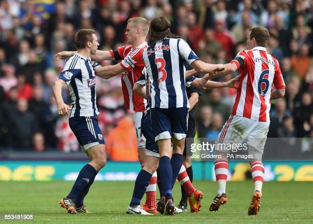 West Bromwich Albion's Gareth McAuley and Stoke City's Ryan Shawcross clash during the Barclays Premier League match at The Hawthorns West Bromwich