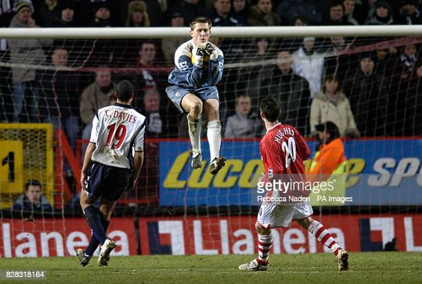 West Bromwich Albion's goalkeeper Tomasz Kuszczak claims the ball ahead of West Bromwich Albion's Curtis Davies and Charlton Athletic's Bryan Hughes
