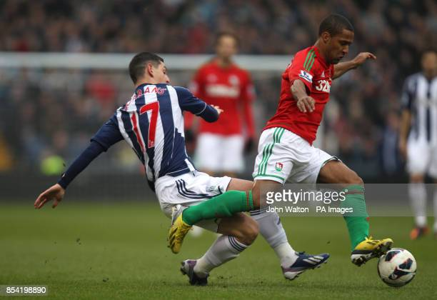 West Bromwich Albion's Graham Dorrans and Swansea City's Wayne Routledge battle for possession of the ball during the Barclays Premier League match...