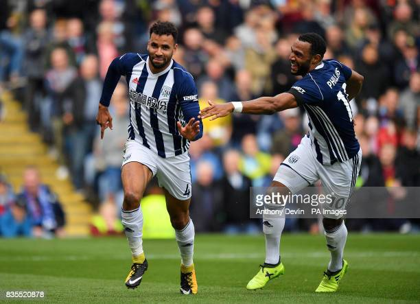 West Bromwich Albion's Hal RobsonKanu celebrates scoring his side's first goal with teammate Matt Phillips during the Premier League match at Turf...