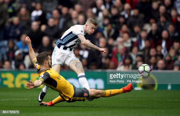 West Bromwich Albion's James McClean shoots as Arsenal's Shkodran Mustafi attempts to block during the Premier League match at The Hawthorns West...