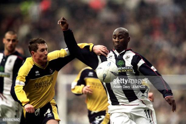 West Bromwich Albion's Jason Roberts and Cheltenham Town's Anthony Griffin battle for the ball