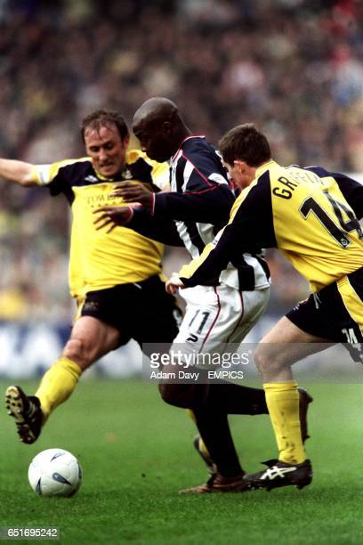 West Bromwich Albion's Jason Roberts gets past Cheltenham Town's Anthony Griffin