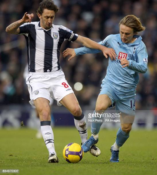 West Bromwich Albion's Jonathan Greening and Tottenham Hotspur's Luka Modric battle for the ball