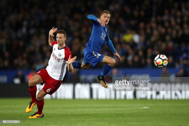 West Bromwich Albion's Jonny Evans and Leicester City's Jamie Vardy battle for the ball during the Premier League match at the King Power Stadium...
