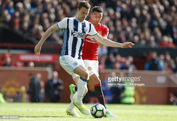 West Bromwich Albion's Jonny Evans and Manchester United's Jesse Lingard in action during the Premier League match at Old Trafford Manchester