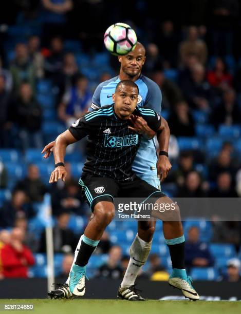 West Bromwich Albion's Jose Salomon Rondon and Manchester City's Vincent Kompany battle for the ball