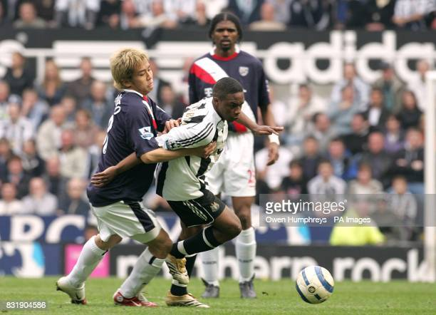 West Bromwich Albion's Junichi Inamoto holds back Newcastle United's Charles N'Zogbia