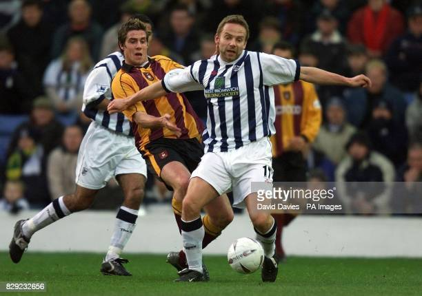 West Bromwich Albion's Larus Sigurdsson holds off Bradford City's Andy Gray from the ball during their FA Cup Third Round match at the Hawthorns...