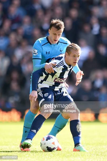 West Bromwich Albion's Matej Vydra and Tottenham Hotspur's Vlad Chiriches battle for the ball