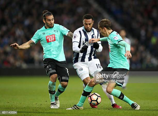 West Bromwich Albion's Matt Phillips is tackled by Derby County's Julien de Sart and Bradley Johnson during the Emirates FA Cup Third Round match at...