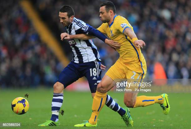 West Bromwich Albion's Morgan Amalfitano tussles for the ball with Crystal Palace's Damien Delaney during the Barclays Premier League match at the...