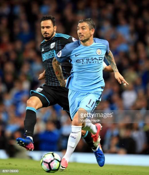 West Bromwich Albion's Nacer Chadli and Manchester City's Aleksandar Kolarov battle for the ball