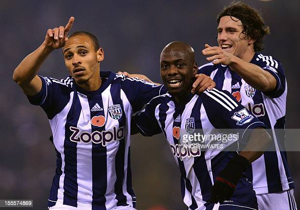 West Bromwich Albion's Nigerian forward Peter Odemwingie celebrates with West Bromwich Albion's Congolese defender Youssuf Mulumbu and West Bromwich...