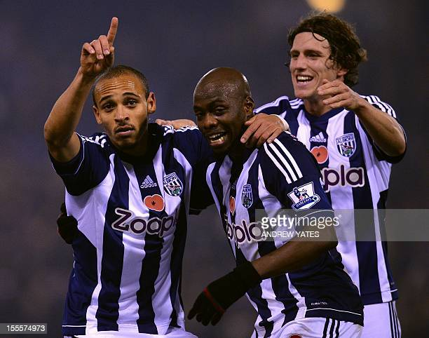 West Bromwich Albion's Nigerian forward Peter Odemwingie celebrates with teammates Congolese defender Youssuf Mulumbu and English defender Billy...