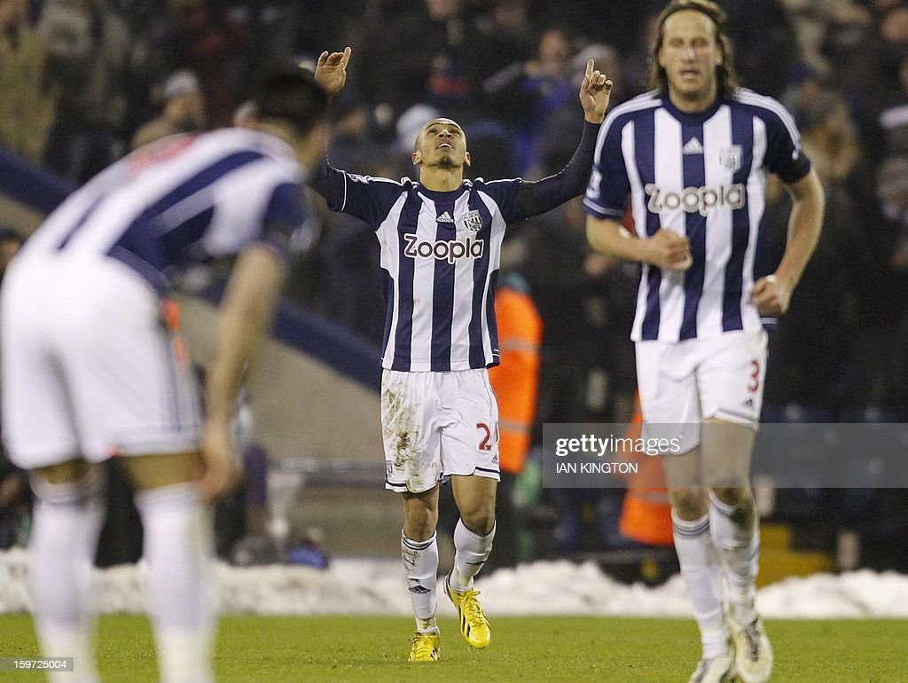 """West Bromwich Albion's Nigerian striker Peter Odemwingie (C) celebrates scoring an equalising goal during the English Premier League football match between West Bromwich Albion and Aston Villa at The Hawthorns in West Bromwich on January 19, 2013. The match ended in a 2-2 draw. AFP PHOTO/Ian KINGTON - RESTRICTED TO EDITORIAL USE. No use with unauthorized audio, video, data, fixture lists, club/league logos or """"live"""" services. Online in-match use limited to 45 images, no video emulation. No use in betting, games or single club/league/player publications."""
