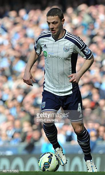 West Bromwich Albion's Northern Irish defender Chris Baird plays the ball during the English Premier League football match between Manchester City...