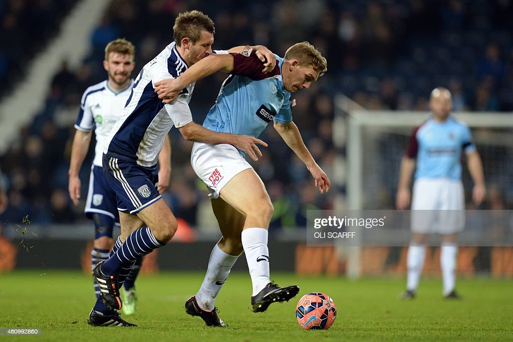 West Bromwich Albion's Northern Irish defender Gareth McAuley vies with Gateshead's English striker Danny Wright during the English FA Cup third...