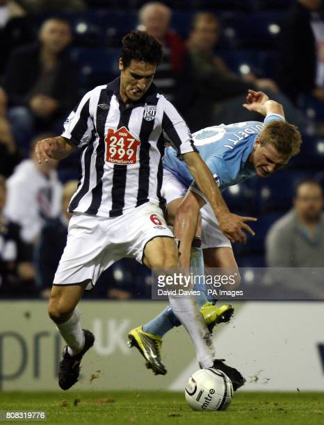 West Bromwich Albion's Pablo Ibanez holds off Manchester City's John Guidetti during the third round Carling Cup match at the Hawthorns West Bromwich
