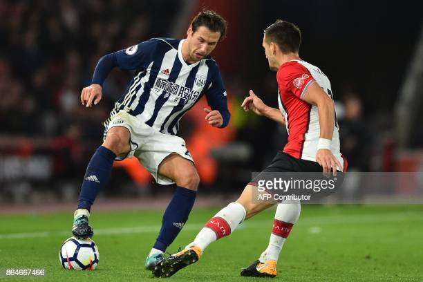 West Bromwich Albion's Polish midfielder Grzegorz Krychowiak vies with Southampton's Serbian midfielder Dusan Tadic during the English Premier League...