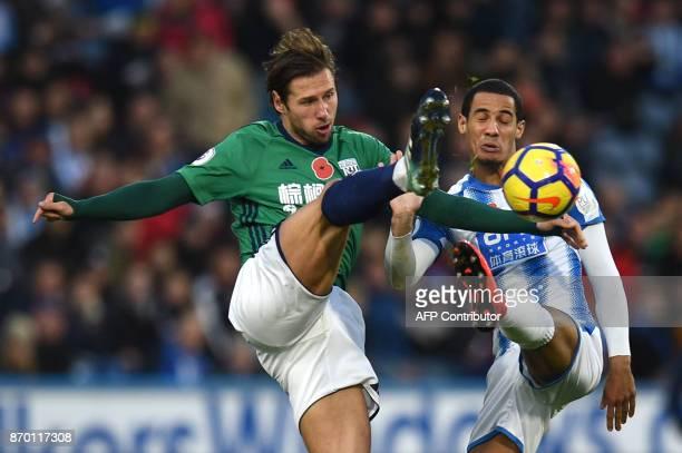TOPSHOT West Bromwich Albion's Polish midfielder Grzegorz Krychowiak vies with Huddersfield Town's Danish defender Mathias Jorgensen during the...