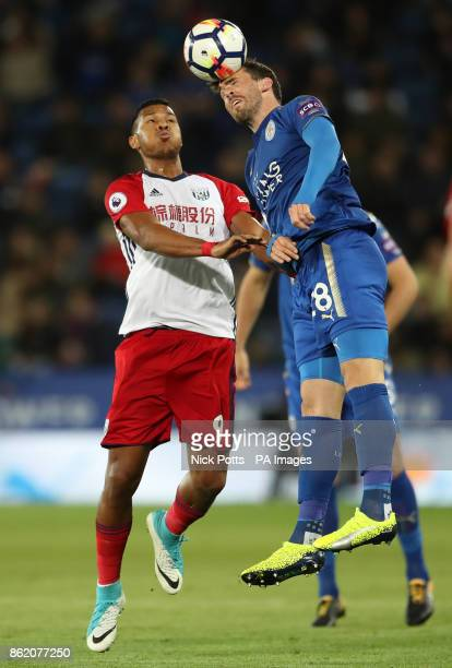 West Bromwich Albion's Salomon Rondon and Leicester City's Christian Fuchs battle for the ball during the Premier League match at the King Power...