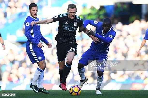 West Bromwich Albion's Scottish midfielder Darren Fletcher vies with Chelsea's French midfielder N'Golo Kante and Chelsea's Belgian midfielder Eden...