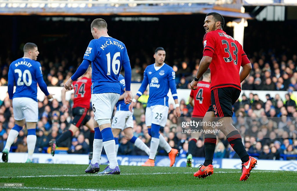 West Bromwich Albion's Venezuelan striker Salomon Rondon (R) reacts after scoring his team's first goal during the English Premier League football match between Everton and West Bromwich Albion at Goodison Park in Liverpool, north west England on February 13, 2016. / AFP / LINDSEY PARNABY / RESTRICTED TO EDITORIAL USE. No use with unauthorized audio, video, data, fixture lists, club/league logos or 'live' services. Online in-match use limited to 75 images, no video emulation. No use in betting, games or single club/league/player publications. /