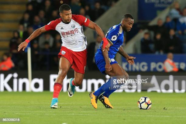 West Bromwich Albion's Venezuelan striker Salomon Rondon vies with Leicester City's Englishborn Jamaican defender Wes Morgan during the English...