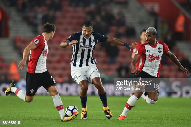 West Bromwich Albion's Venezuelan striker Salomon Rondon vies with Southampton's Germanborn Portuguese defender Cedric Soares and Southampton's...