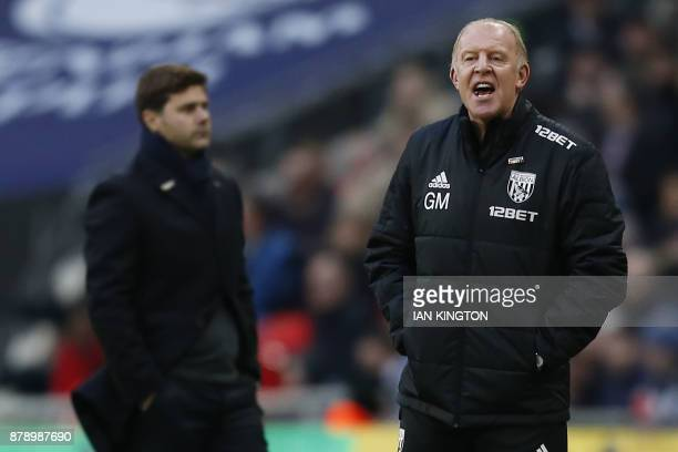 West Bromwich caretaker coach Gary Megson and Tottenham Hotspur's Argentinian head coach Mauricio Pochettino gesture during the English Premier...