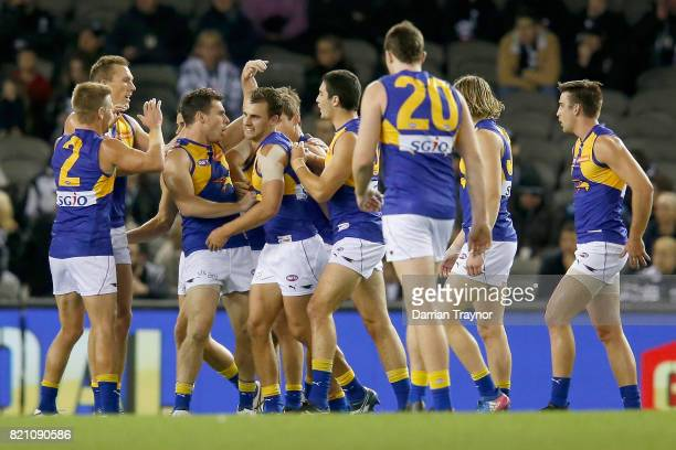 West Coast Eagles player celebrate a goal on the quater time siren during the round 18 AFL match between the Collingwood Magpies and the West Coast...