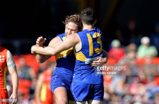 West Coast Eagles player Luke Shuey is congratulated by team mates after kicking a goal during the round 11 AFL match between the Gold Coast Suns and...