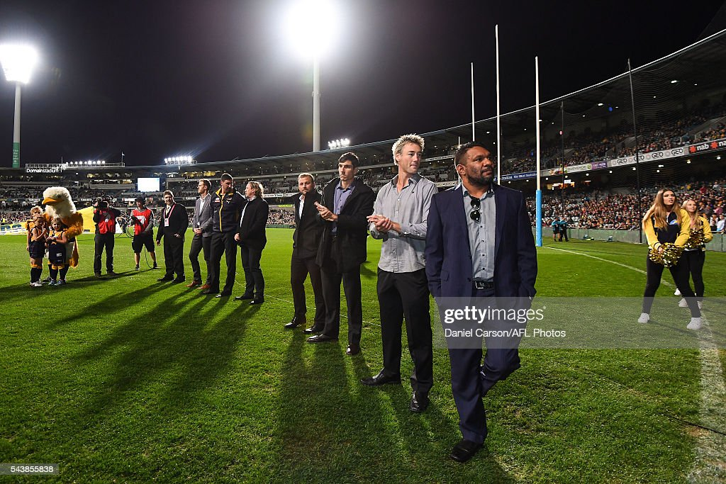 West Coast Eagles Premiership players form a guard of honour to welcome the current Eagles on the arena during the 2016 AFL Round 14 match between the West Coast Eagles and the Essendon Bombers at Domain Stadium on June 30, 2016 in Perth, Australia.