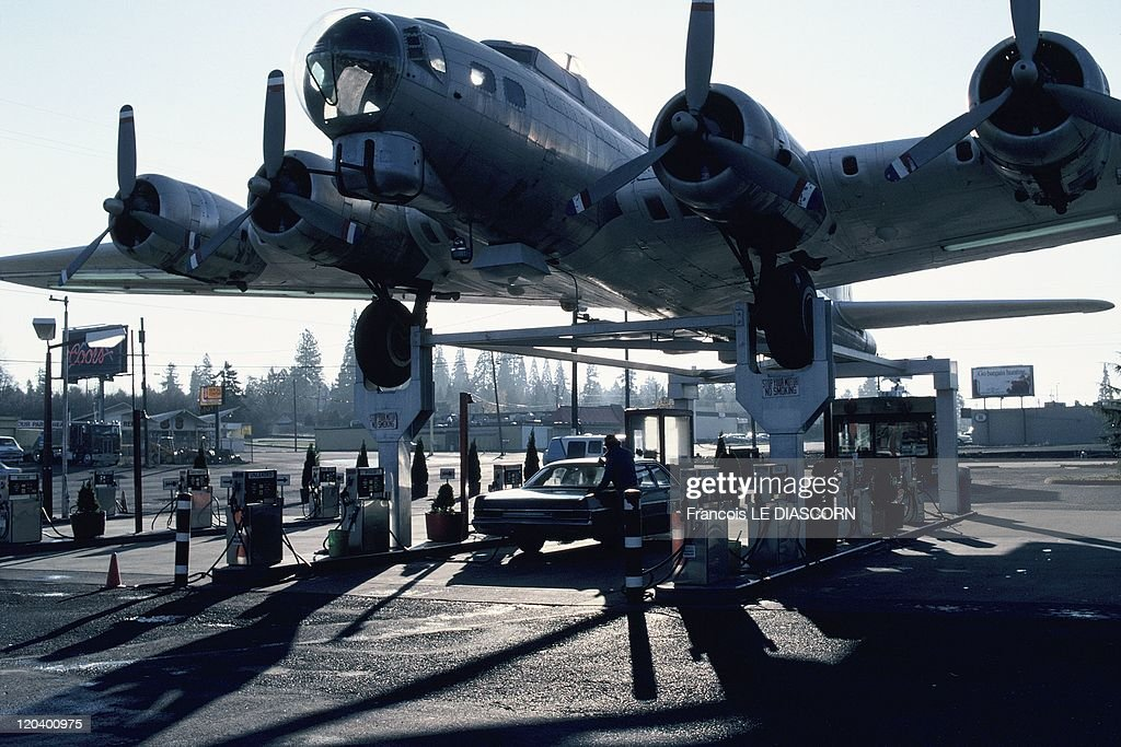 West Coast In Route 101 In Oregon, United States In 1997 - Route 101, called also in some parts Route 1-World War II bomber in a service station near Tillamook.