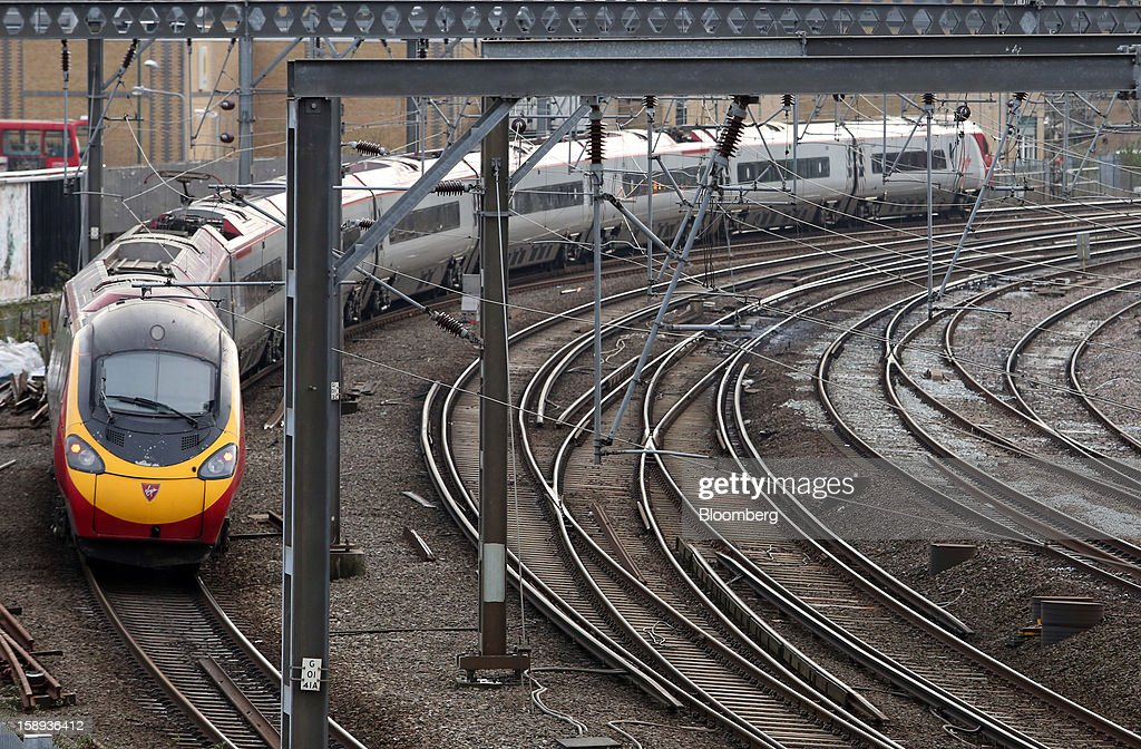 A West Coast train, operated by Virgin Trains, arrives at Euston railway station in London, U.K., on Thursday, Jan. 3 2013. Rail commuters have been hit by inflation busting fare increases of up to 10 per cent, adding hundreds of pounds to the cost of annual season tickets. Photographer: Chris Ratcliffe/Bloomberg via Getty Images