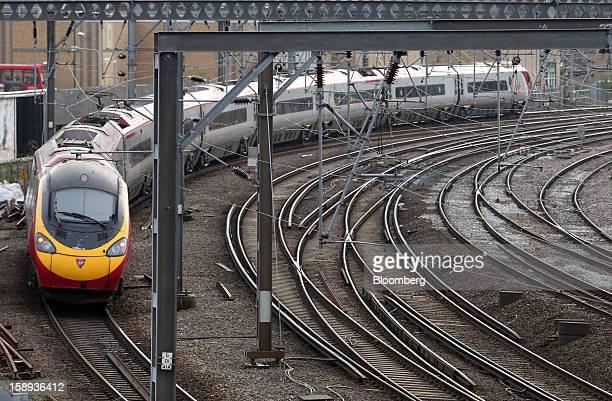 A West Coast train operated by Virgin Trains arrives at Euston railway station in London UK on Thursday Jan 3 2013 Rail commuters have been hit by...