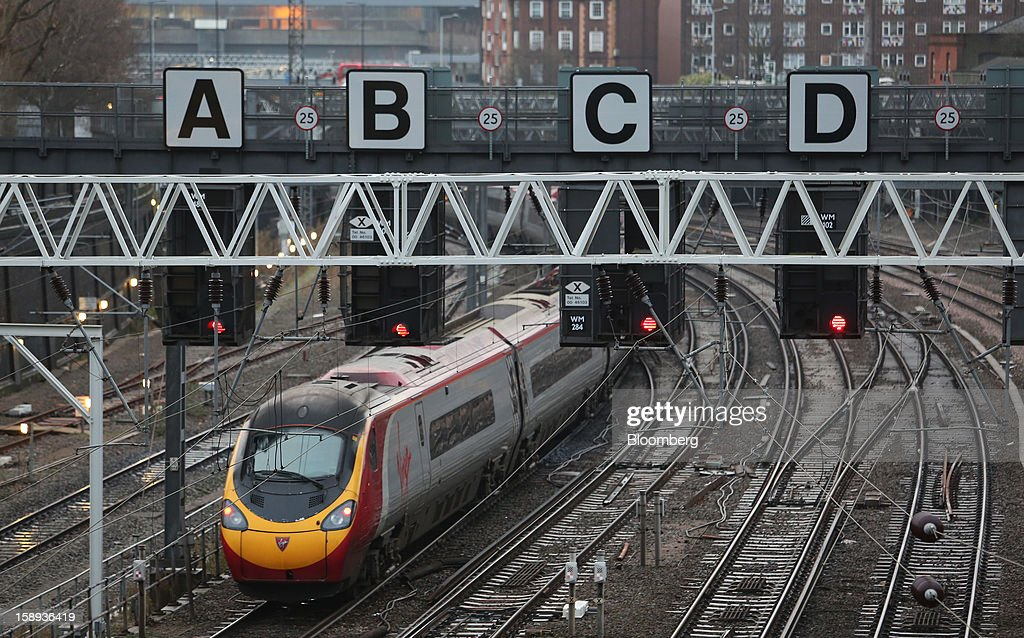 A West Coast train, operated by Virgin Trains, is seen leaving Euston railway station in London, U.K., on Thursday, Jan. 3 2013. Rail commuters have been hit by inflation busting fare increases of up to 10 per cent, adding hundreds of pounds to the cost of annual season tickets. Photographer: Chris Ratcliffe/Bloomberg via Getty Images