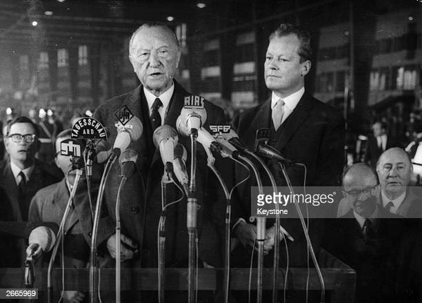 West German Chancellor Konrad Adenauer makes his farewell speech in Berlin before resigning from office Standing next to him is German statesman...