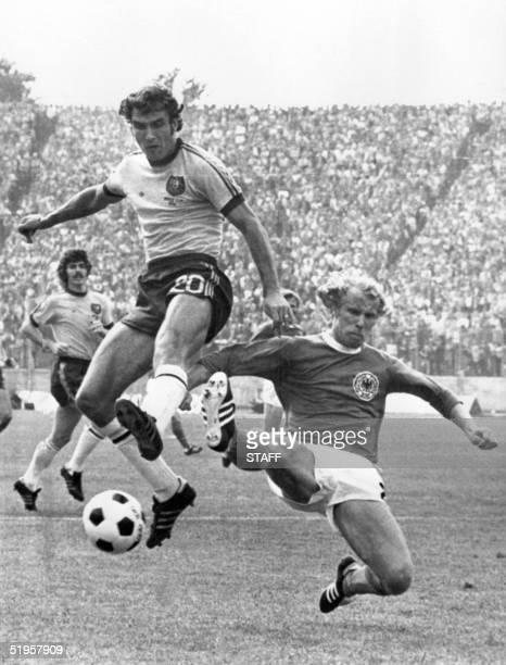 West German defender Berti Vogts tackles Australian forward Branko Buljevic during the World Cup first round soccer match between West Germany and...