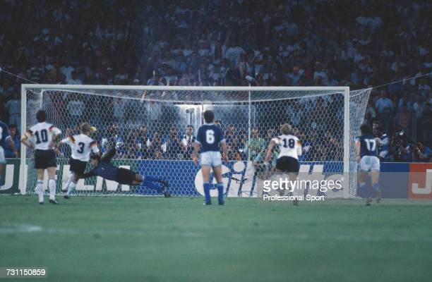 West German footballer Andreas Brehme scores from the penalty spot in the 85th minute of the 1990 FIFA World Cup Final between West Germany and...