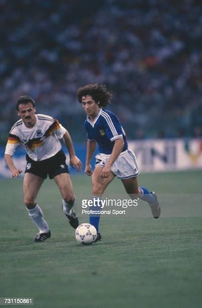 West German footballer Jurgen Kohler attempts to stop a run by Argentine midfielder Pedro Troglio in the 1990 FIFA World Cup Final between West...