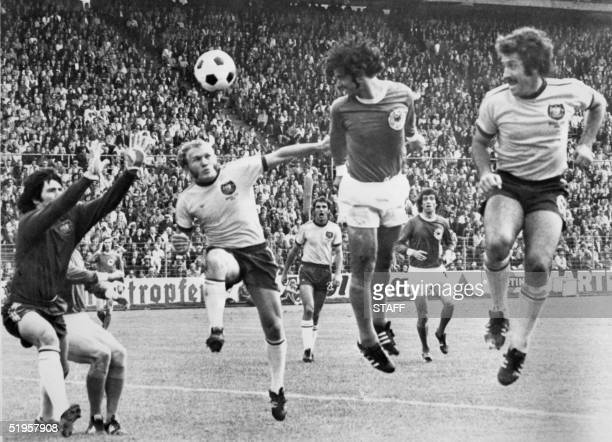 West German forward Gerd Mueller scores on a header past Australian goalkeeper Jack Reilly and defenders Manfred Schaefer and Ray Richards during the...