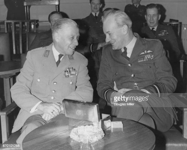West German General Adolf Heusinger Inspector General of the Bundeswehr with Sir Hector McGregor CommanderinChief of Fighter Command in the HQ...