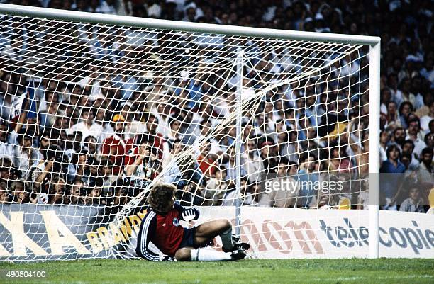 West German goalkeeper Harald Schumacher fails to stop a goal during the 1982 World Cup semifinal football match between West Germany and France on...
