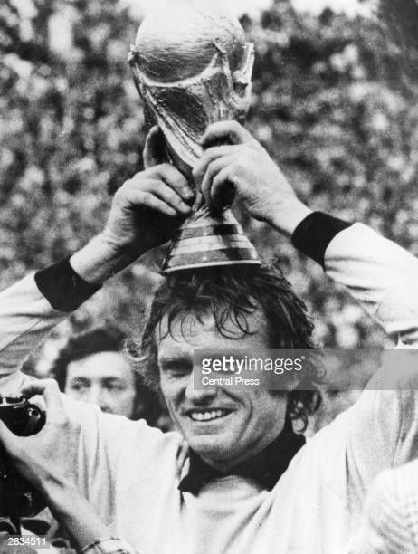 West German goalkeeper Sepp Maier balances the World Cup on his head after West Germany's 21 victory over Holland in the World Cup final in Munich